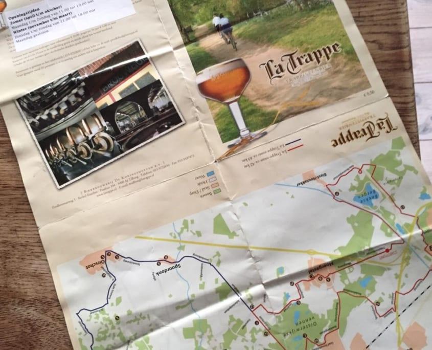 Deze kaart kun je zowel bij de VVV TIlburg als bij De Koningshoeven halen