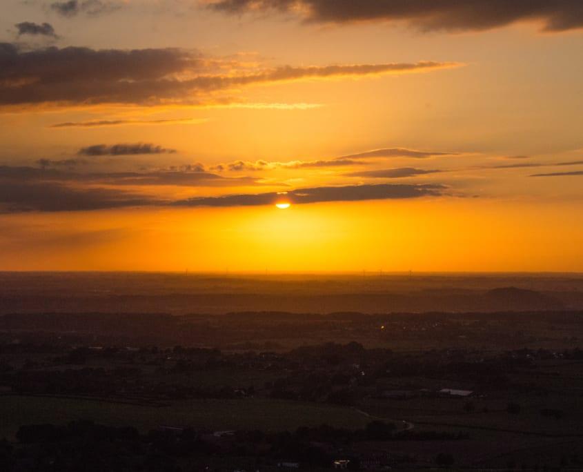 Genieten van de zonsondergang tijdens je ballonvaart.