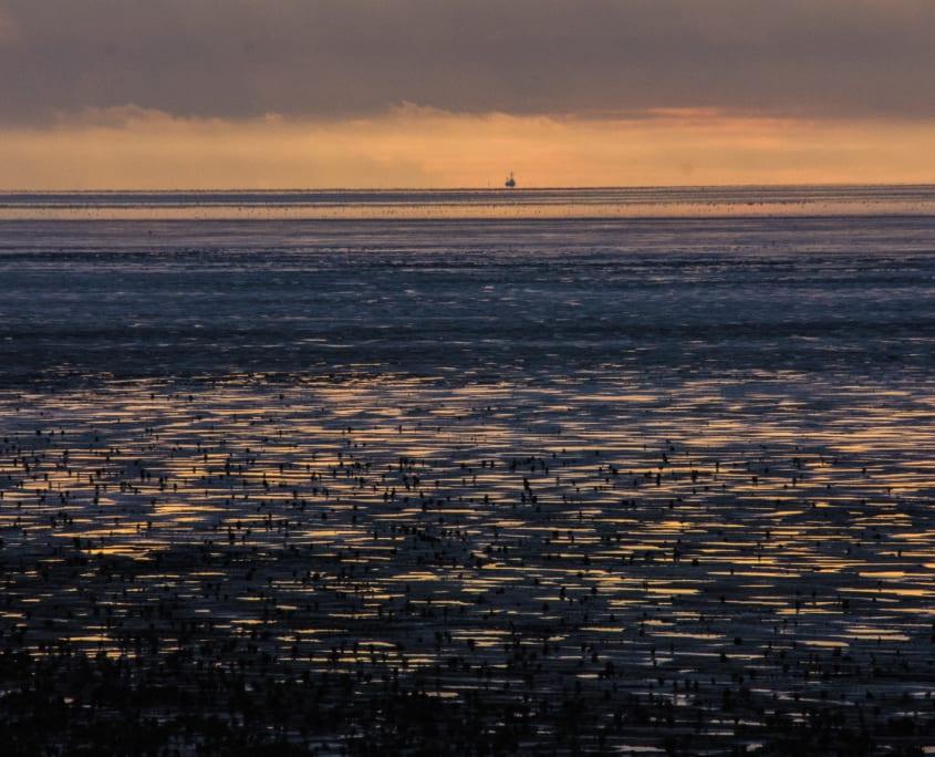 Zonsondergang boven de Waddenzee: versie 1